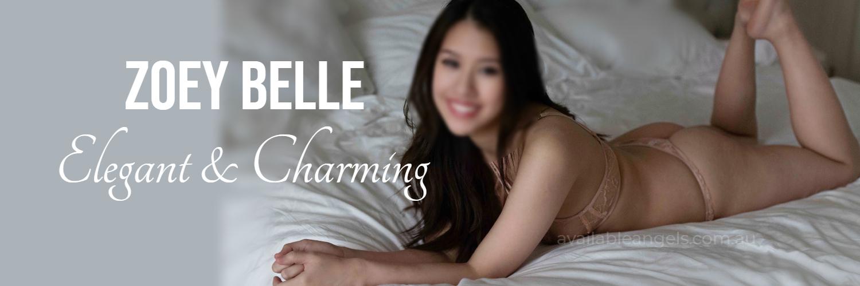 asian brunette escort woman on bed in lingerie